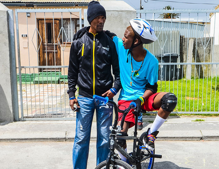 A citizen-driven initiative, Open Streets, is trying to change how streets in Cape Town are used – so that they become more friendly for pedestrians, cyclists, skateboarders and children, not just cars. This photo was taken along Rubusana Street during Open Streets in Langa in October 2013.