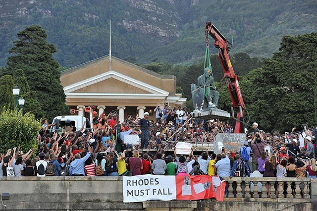 Students cheer as a statue of Cecil John Rhodes is removed from the University of Cape Town in April 2015.