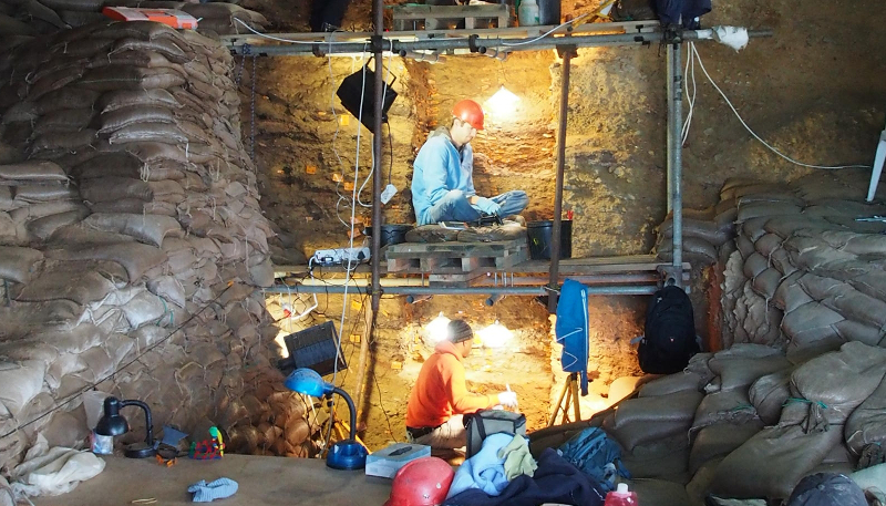 Findings from this excavation site at Mossel Bay and others in South Africa have helped to reveal how ancient humans survived a massive volcano eruption 74 000 years ago.  Photo by Curtis Marean