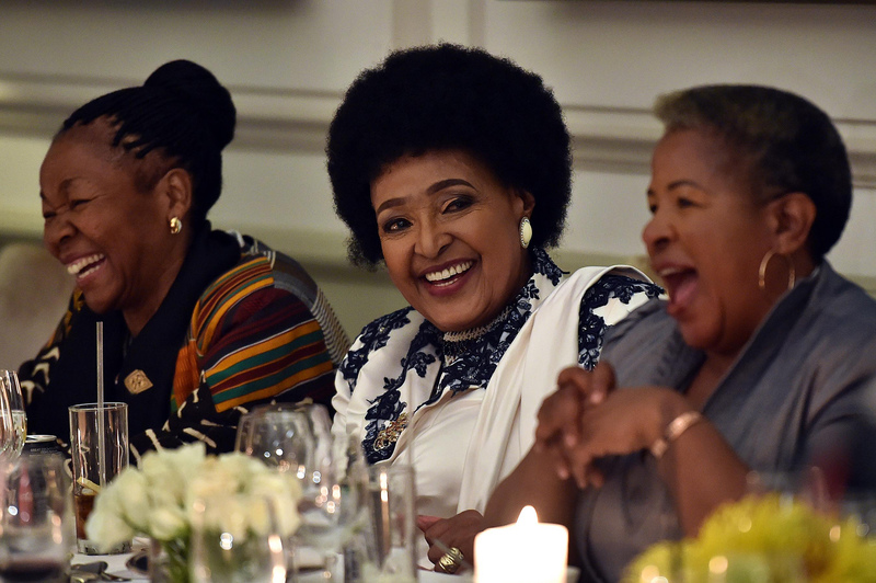 Winnie Madikizela-Mandela shares a light moment at her 80th birthday celebrations held at Mount Nelson Hotel in Cape Town. (Photo: GCIS)