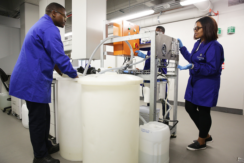 Chemical engineering students work with the reverse osmosis plant to desalinate seawater.