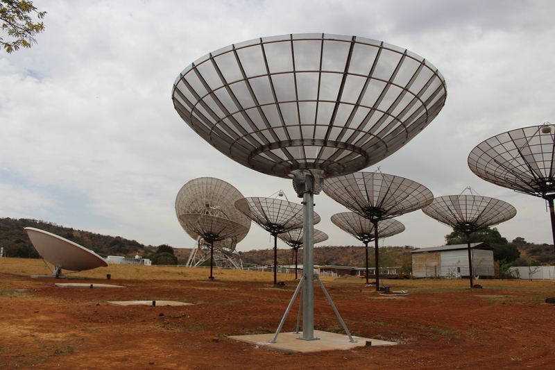 The 10-dish HIRAX telescope prototype array recently installed at a test site near Johannesburg. The final HIRAX telescope will allow scientists to research the early universe.