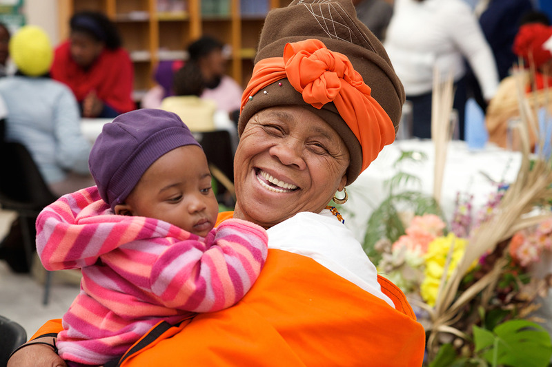 A grandmother and her grandchild attending the Parenting for Lifelong Health programme for young children: a parenting programme co-developed by UCT that aims to promote positive parenting and child wellbeing.