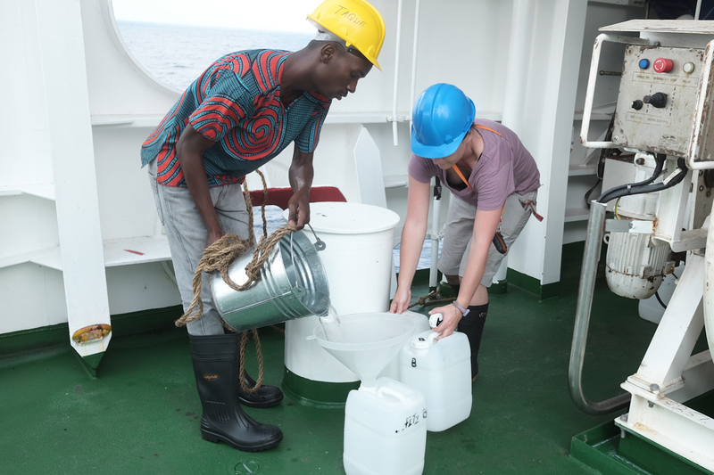 Vonica Perold (right), a doctoral researcher at the UCT FitzPatrick Institute of African Ornithology, and Manuel Taque (left), from the Mozambique Ministry of Sea, Inland Waters and Fisheries, sample seawater onboard the South African ship SA Agulhas II. <b>Photo</b> Peter G. Ryan.
