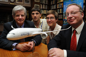 Prof Christiaan Redelinghuys and master's students Nicholas Bizinos and Drewan Sanders, with Airbus' Dale King
