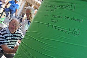 Dugald Macdonald and Prof Mike Meadows pen their messages of good luck on the 'Green Mile'