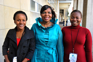 Maletsabisa Molapo (left) and Joyce Mwangama (right) celebrated their scholarship coup with Minister of Communications Dina Pule