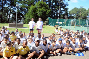 learners on tennis court