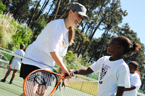 Lindokuhle Gwele of St. Mary's Primary with coach Jessica Ellis