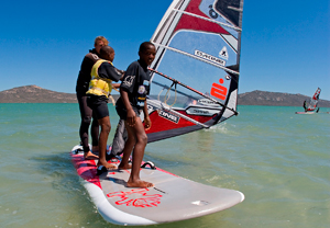 Learners on the Yacht Club's outreach programme get the hang of windsurfing