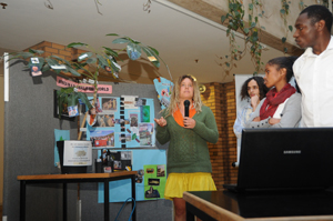 Student Isabelle Giddy presents at a ceremony to celebrate the UCT Global Citizenship