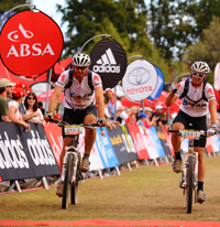 Prof Marc Mendelson and his son, Ben, finish the Absa Cape Epic