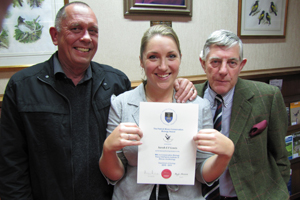 Sarah Lewis congratulated by Prof Phil Hockey and Peter Johnson