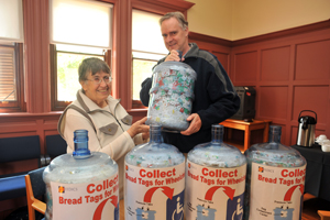 Grant Willis (right) hands over the bread tags to Mary Honeybun