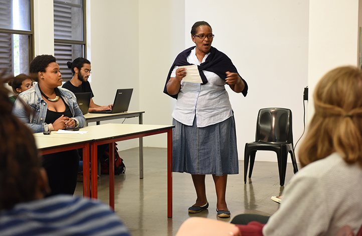 Nozizwe Beya of Nehawu and SuperCare speaks at a 19 March public meeting of students, staff members and outsourced workers to discuss transformation at the university, . Photo by Michael Hammond.