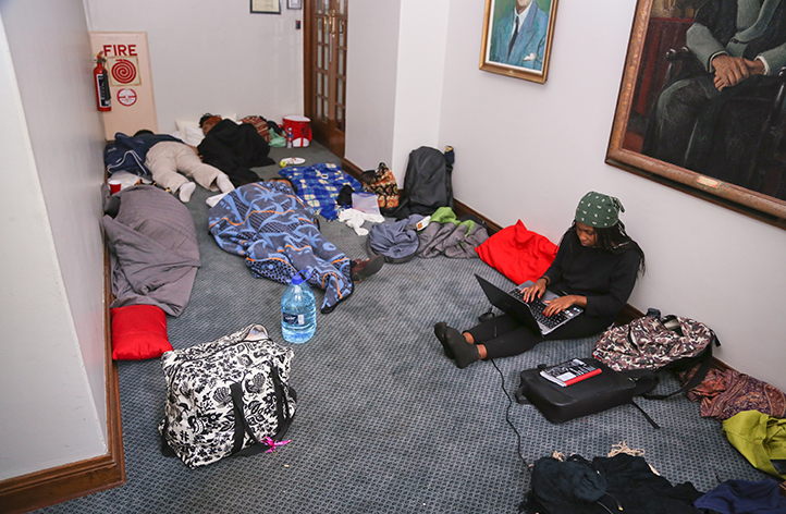 Seminars, teach-ins and debates were the order of the days and the nights in Azania House. Here, students catch up on sleep and work. Photo by Je'nine May.