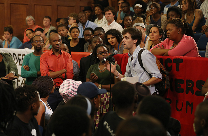 The University Assembly in Jameson Hall on 25 March was one of the biggest civil-action gatherings the hall has seen in recent years. Here, a student takes the mic to express his views on transformation, the Rhodes statue and UCT's institutional climate. Photo by Je'nine May.