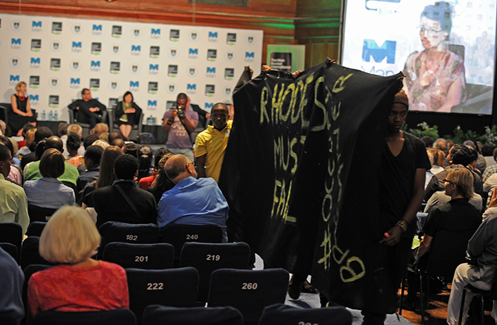 Students holding a silent protest during the Man Booker International Prize panel discussion at Jameson Hall on 23 March. They entered the hall with a black banner and posters and stood in silence in front of the stage for 10 minutes before leaving. Photo by Michael Hammond.