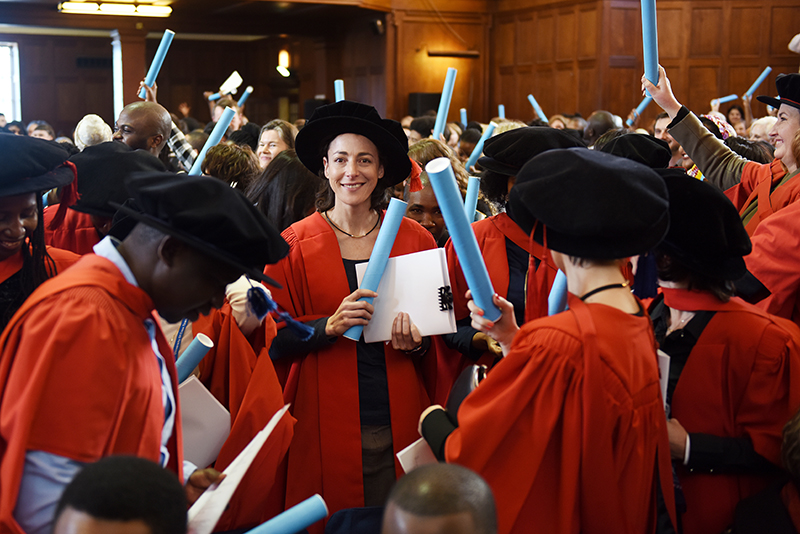 A flurry of red gowns at the July PhD graduation. More than 100 PhD graduands were capped at the ceremonies on Friday 14 July.
