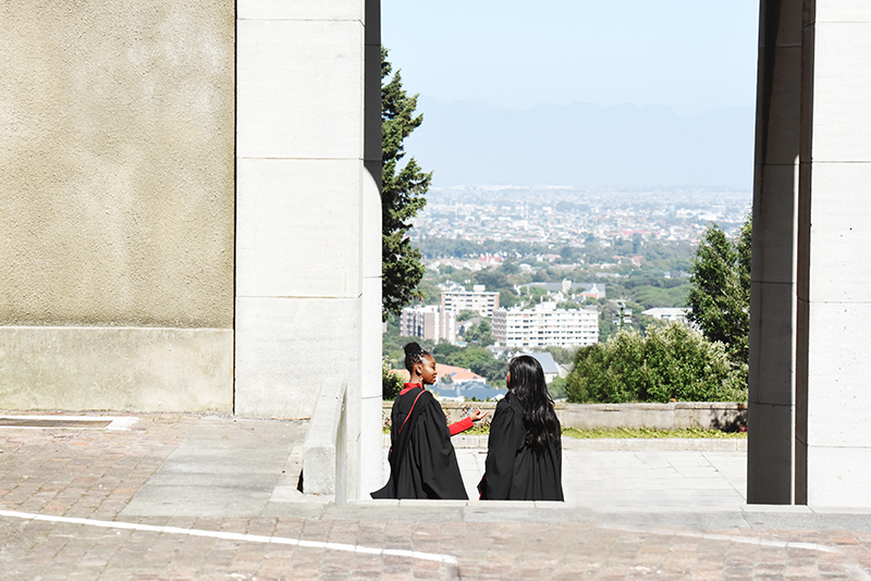 Two Faculty of Health Sciences graduates having a conversation outside Memorial Hall after their graduation ceremony. The December graduation ceremonies, held on Wednesday 20 December, ended the academic year at UCT.