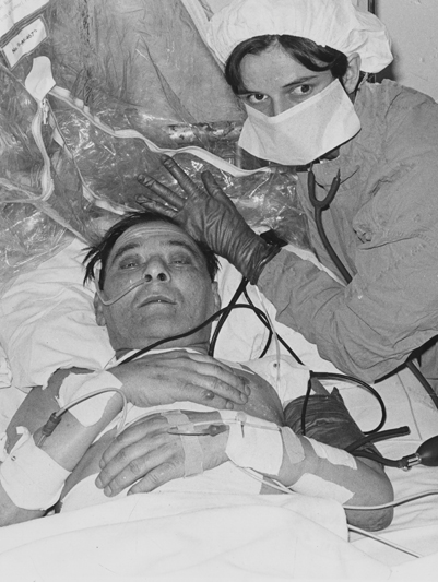 A nursing staff member helps Louis Washkansky, the world's first successful heart transplant patient, after the marathon six-hour operation. Washkansky lived for 18 days after the operation, before dying of pneumonia-related complications.