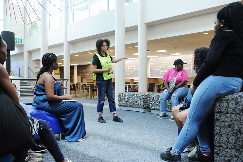 A library assistant explains how the Chancellor Oppenheimer Library operates, during a tour of the UCT libraries with first-year students.