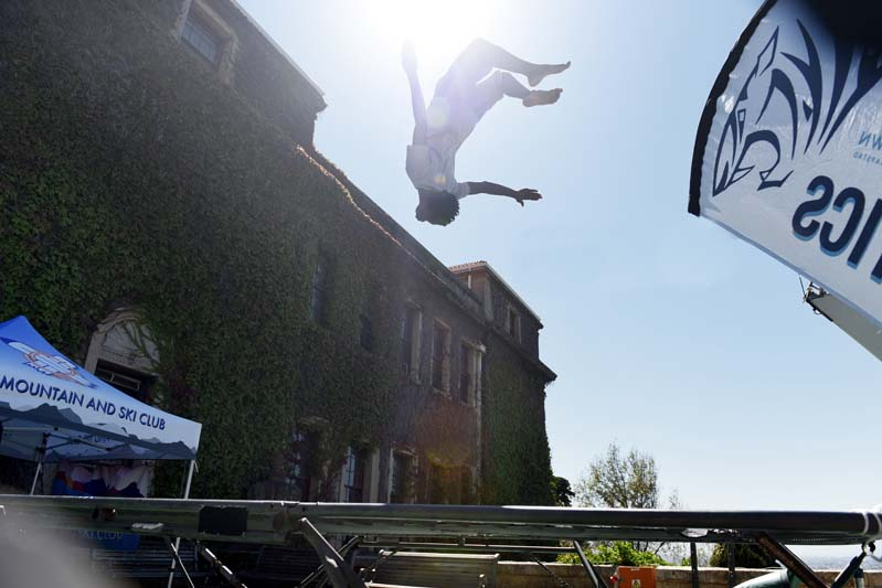 A student from the UCT Gymnastics shows off his backflipping tricks during Plaza Week.