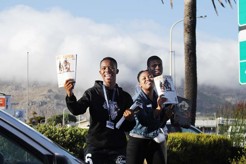 First-year students sell the annual Sax Appeal magazine on the corner of White and Main roads, Tokai.