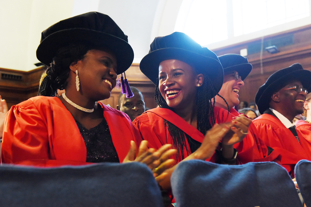 PhD students enjoy their first moments after being capped.