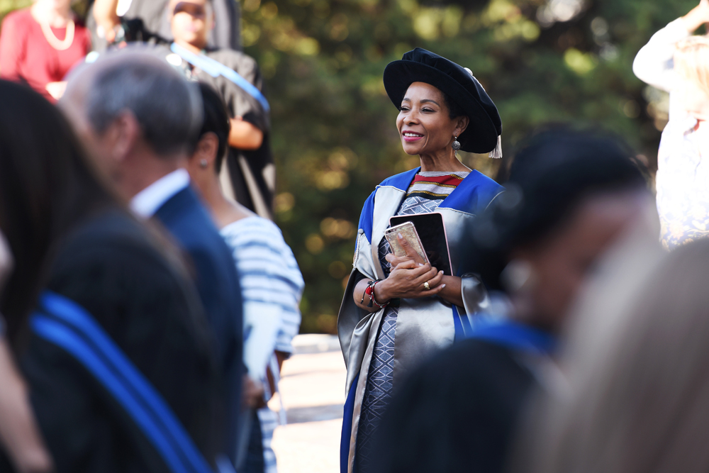 Deputy Vice-Chancellor Prof Mamokgethi Phakeng watches as graduates celebrate with their families.