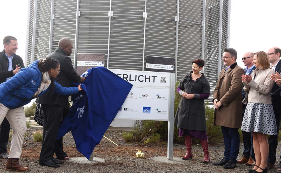Department of Science and Technology director-general Phil Mjwara and UCT Deputy Vice-Chancellor Professor Loretta Feris unveil the new telescope in Sutherland.