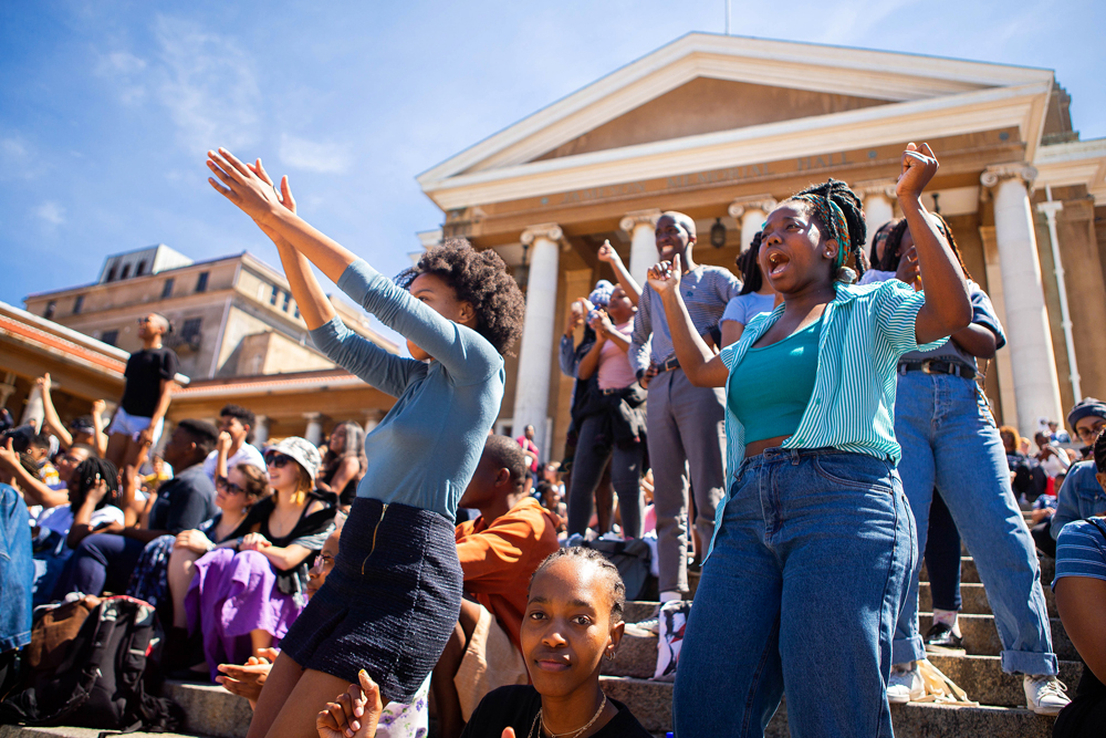 Students sing along and enjoy some fun in the sun as the 3 Divas perform.