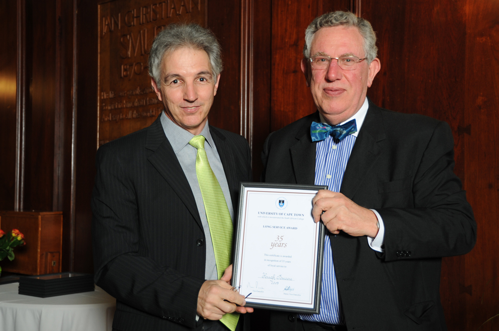 Former UCT Registrar Hugh Amoore receives his long-service award from Dr Price in 2009, after 35 years of service.