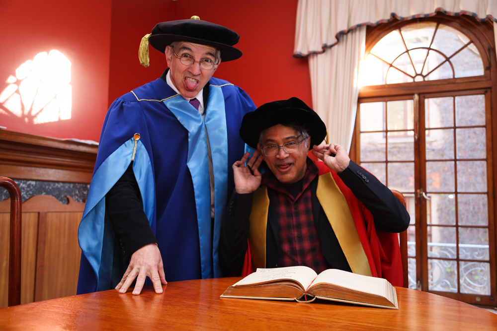 Dr Price shares a light-hearted moment with honorary graduate Zackie Achmat in the moments leading up to the July 2017 graduation ceremonies.