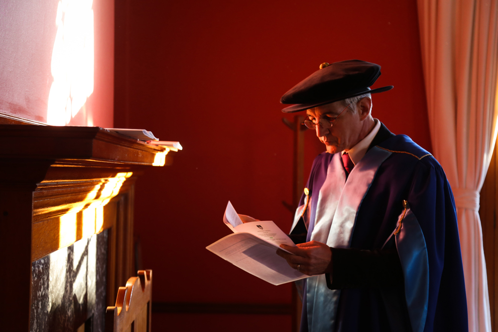 Dr Price takes a moment to collect his thoughts before a graduation ceremony in 2017.