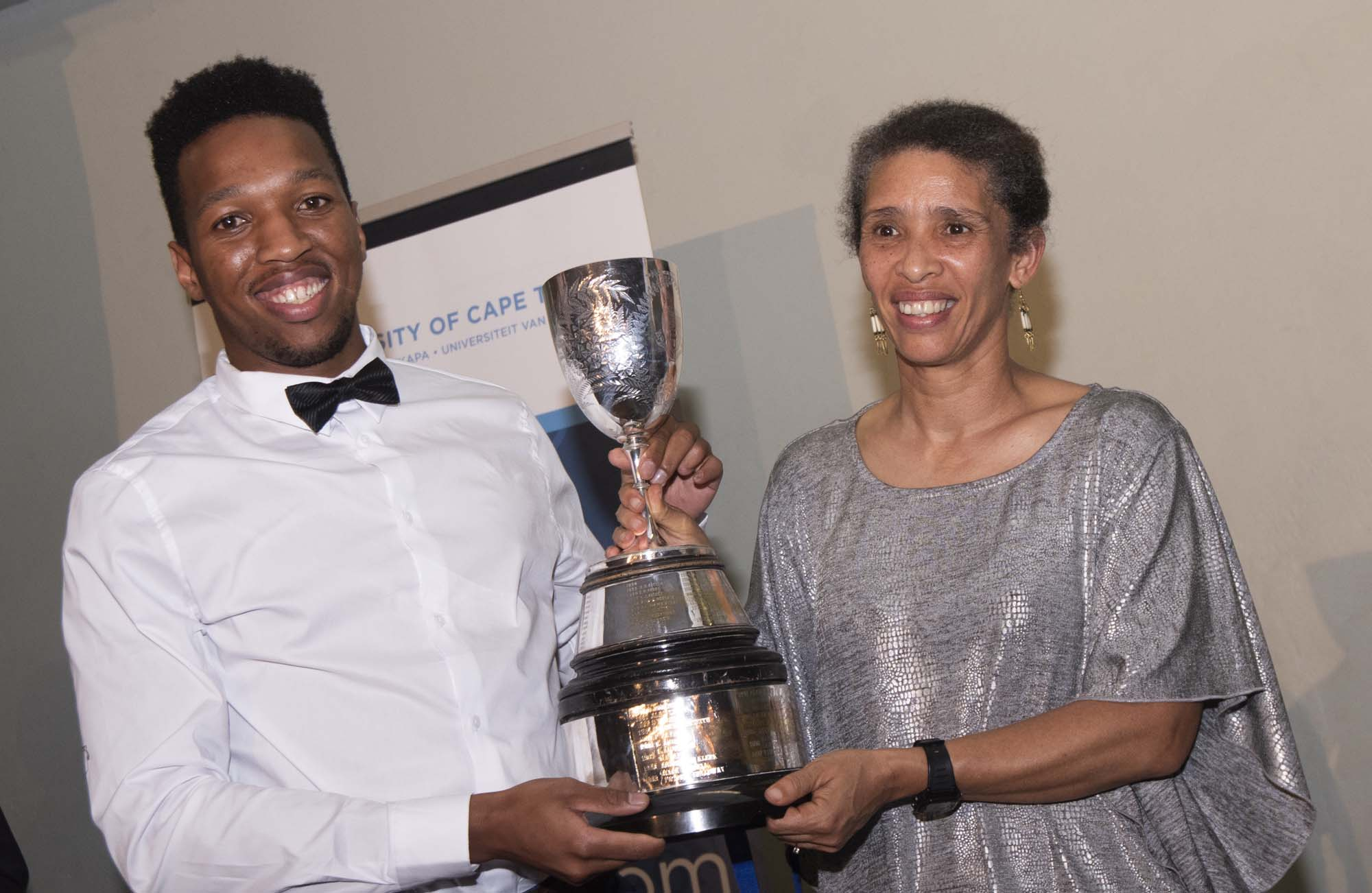Edwina Brooks, director of Student Affairs, presents UCT sprint sensation Mpumelelo Mhlongo with the Jamison Cup for an incredible fifth consecutive year.