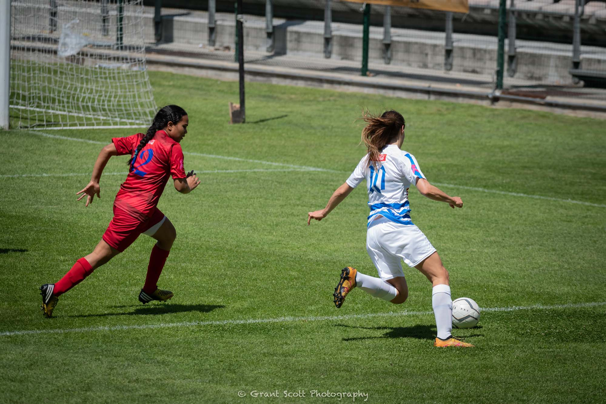 Captain Nina Woermann in action against Cape Town Spurs Women's Football Club in a game that saw the UCT women's football team taking home the Coca-Cola Cup with a 2–0 victory.