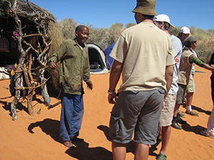 The late Oom Dawid Kruiper talking to UCT student on a field trip to the Kgalagadi Transfrontier Park