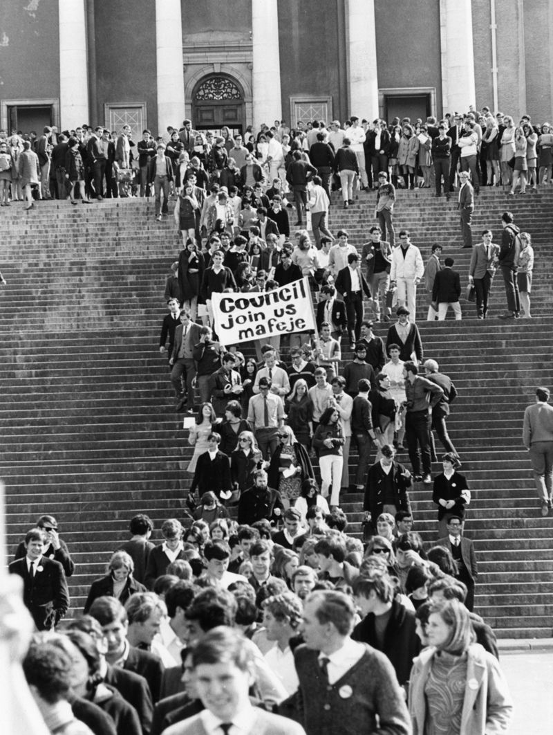 Students march from Jameson (now Memorial) Hall to protest the overturning of black academic Archie Mafeje's appointment as senior lecturer, social anthropology, at UCT.